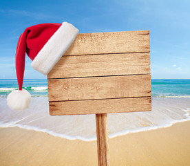 Christmas party on beach signboard as background