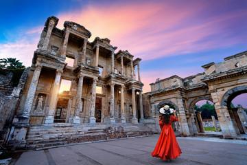 Woman standing in Celsus Library at Ephesus ancient city in Izmir, Turkey.