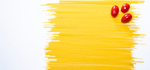 Dry spaghetti on a white background. Italian pasta. A place to copy. Food and healthy eating. Isolated