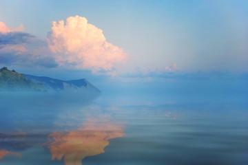 seascape sunset sun sets orange Cumulus clouds sea waves. stones coast