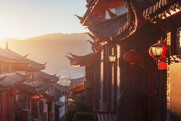 Sunrise view of the empty city street. Lijiang. China.