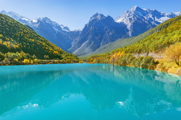 Mountains and lake by Lijiang at autumn day time. Yunnan province. China.