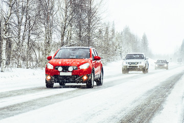 Car in the winter road in Rovaniemi at Lapland, Finland