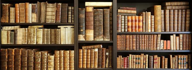 old books on wooden shelf