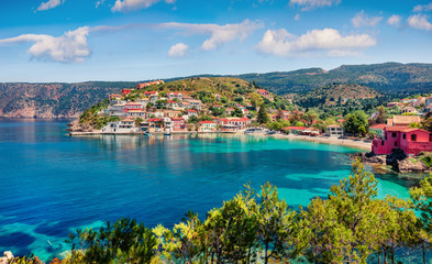 Impressive morning cityscape of Asos village on the west coast of the island of Cephalonia, Greece, Europe. Colorful summer sescape of Ionian Sea. Traveling concept background.