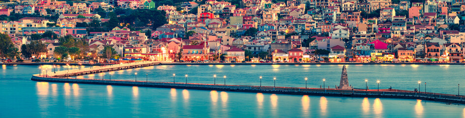 Panoramic morning cityscape of Argostolion town, former municipality on the island of Kefalonia, Ionian Islands, Greece. Impressive summer seascape of Ionian Sea. Traveling concept background.
