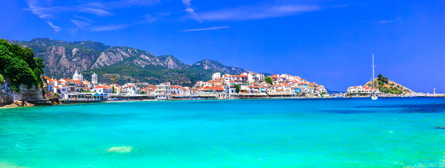 Most beautiful traditional villages of Greece - Kokkari in Samos island. crystal sea and taverns