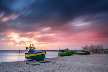 Fishing boats on the beach during sunrise in Gdynia. Baltic Sea. Poland