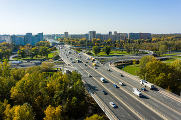 Aerial shot of a big freeway intersection in Warsaw, traffic going fast through many road flyovers. Warsaw, Poland.