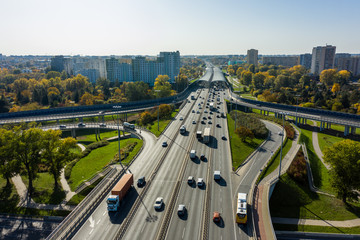 Aerial shot of  big freeway intersection in Warsaw, traffic going fast through many road flyovers. Poland. 30. October. 2019. Aerial view of a motorway with several traffic intersections.