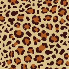 Vector abstract seamless bright animalistic leopard pattern with brown colored stains elements on the beige background