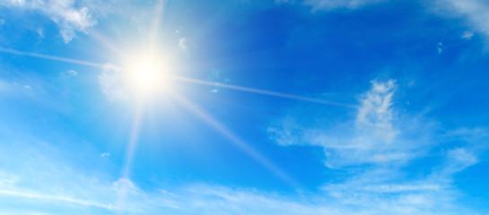 Blue sky. Bright midday sun illuminates the space. Wide photo .