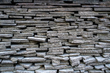 A wall of beautiful stone on the street. Background. Texture.