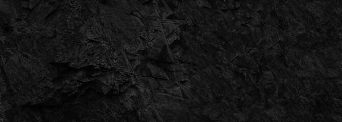 Black stone background. Copy space. Dark rock texture. Black grunge background.