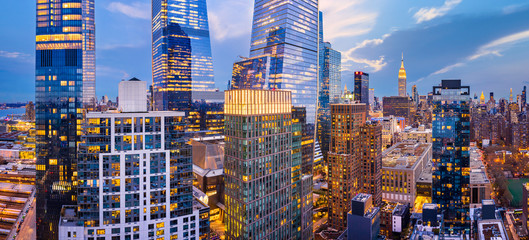 Aerial panorama of New York City skyscrapers at dusk as seen from above the 29th street, close to Hudson Yards and Chelsea neighborhood
