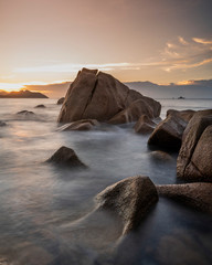 amazing travel landscape photo with Sunset of the iconic rocks of seychelles , Seascape on sea with long exposure and water wave