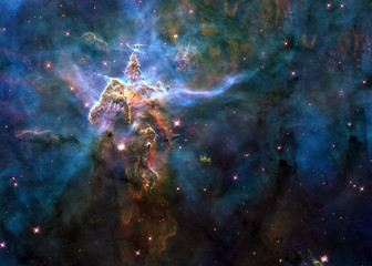 Mystic Mountain of Carina Nebula. Deep space look. Science fiction wallpaper. Elements of this image were furnished by NASA.