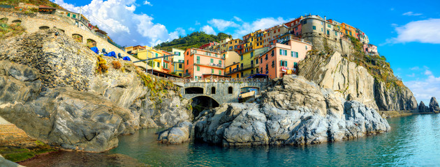View of Manarola town on rocky coast at famous Cinque Terre National Park. Liguria, Italy