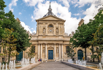 Latin Quarter, Paris, historic building of University of Sorbonne, Chapel of Sorbonne, the square with fountains in front. Paris, France.