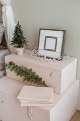 Christmas atmosphere. Bedroom decorated with fir branches and wooden frames.