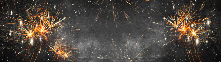Silvester background banner panorama long- firework on rustic dark black grey stone concrete texture, top view with space for text