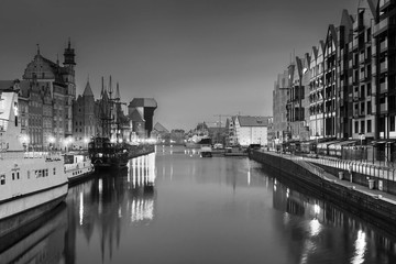 Gdansk with beautiful old town over Motlawa river at night in black and white, Poland.