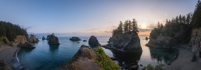 Panorama of Secret Beach in Oregon during a sunset