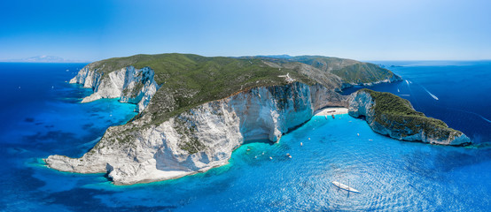 Aerial panorama drone shot of Zakynthos north end with Navagio beach and yachts in Ionian sea
