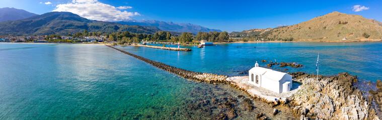 Small white church Saint Nikolaos in the sea, Georgioupoli, Crete, Greece.