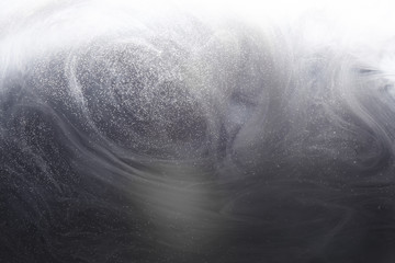 Abstract underwater gray background with bubbles of water. Ray of light through smoke and the thickness of the ocean
