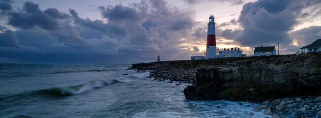 Portland Bill Light house with a stormy sunset