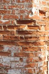 Old brick wall as background, ruined masonry.