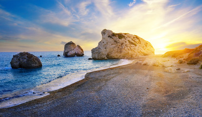 Aphrodite's beach and stone at sunset in bright sunshine