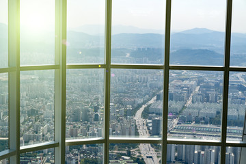 View at Seoul, South Korea from high floor at viewpoint at sunny day through huge windows