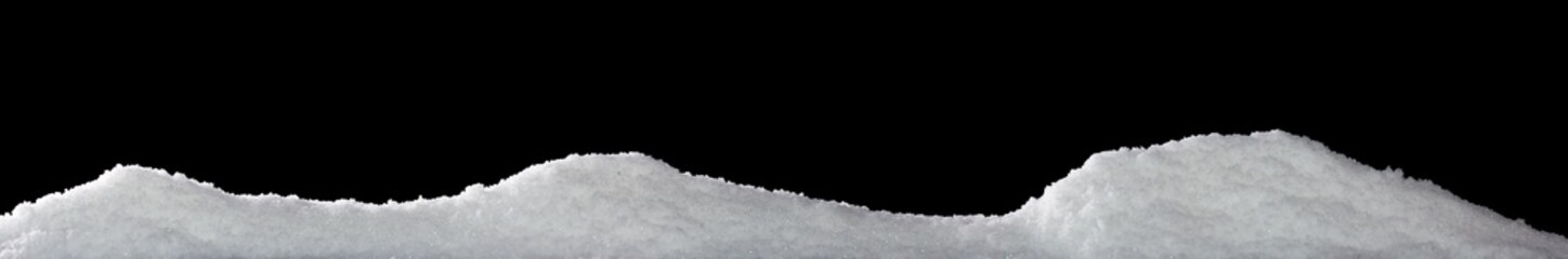 Banner of sparkling fuffy white snow hills isolated on black