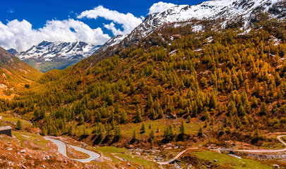 Autumn road view of Gran Paradiso Italian alps mountains in Graian Alps in Piedmont, Italy with snow capped peaks.