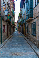 View of a narrow street in the old town of Guimaraes, Portugal