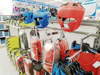 Boxing headgear and boxing gloves are sold in a large sports store