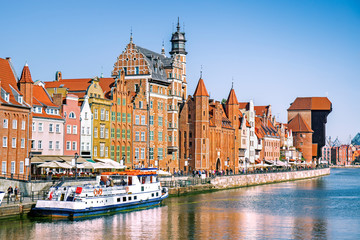 Scenic embankment of the Motlawa river with historical buildings in Gdansk, Poland