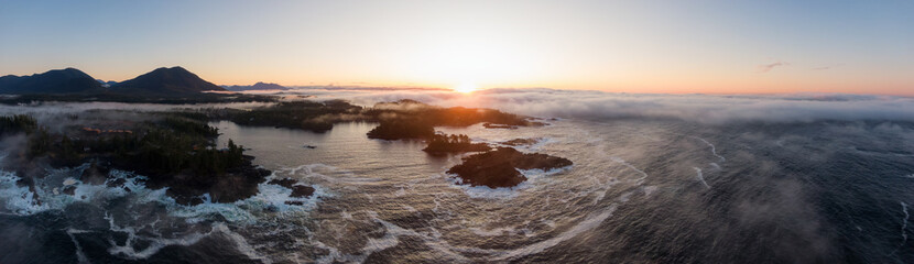 Ucluelet, Vancouver Island, British Columbia, Canada. Aerial Panoramic View of a Small Town near Tofino on a Rocky Pacific Ocean Coast during a cloudy  and colorful morning sunrise.