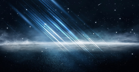 Empty night nature scene. The night starry sky, the rays of the blue neon spotlight. Snowy winter night background.