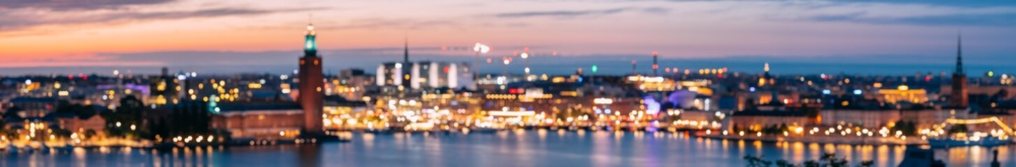 Stockholm, Sweden. Night Skyline Abstract Boke Bokeh Background With Famous Landmarks. Design Backdrop. Tower Of Stockholm City Hall. Panorama