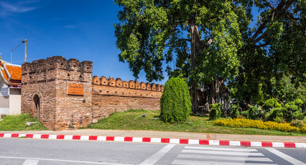 Tha Phae Gate Chiang Mai old town city and street ancient wall at moat (Chiang Mai Gate) is a major tourist attraction in Chiang Mai Northern Thailand.blue sky