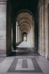 Vertical shot of an outdoor hallway of a historic building with outstanding architecture