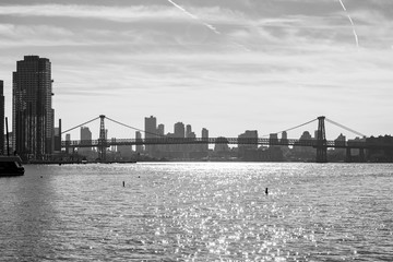 Black and White Photo of the Williamsburg Bridge connecting Manhattan to Brooklyn New York over the East River