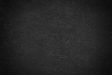 Fondo negro de una pared con manchas.