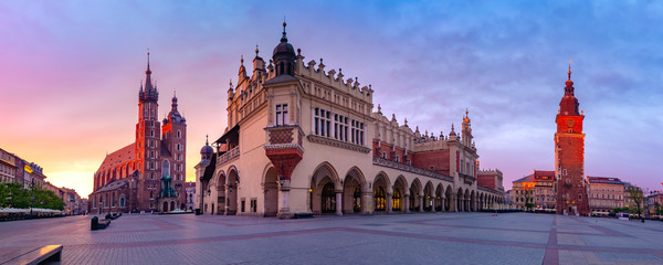 Panorama of Medieval Main market square with Basilica of Saint Mary, Cloth Hall and Town Hall Tower in Old Town of Krakow at sunrise, Poland