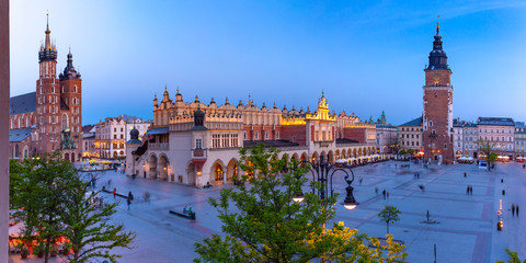 Aerial panorama of Medieval Main market square with Basilica of Saint Mary, Cloth Hall and Town Hall Tower in Old Town of Krakow at night, Poland