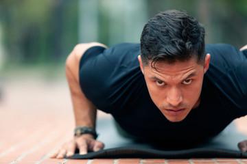 Young man exercising outdoors.