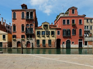 Buildings with beautiful windows near the river in Venice, Italy